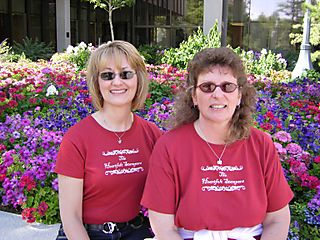 Kriss and Debbie by flowers